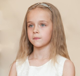 a young blond girl photographed in May 2014, picture 4/14