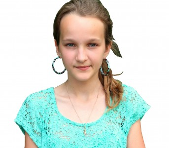 an absolutely beautiful Catholic girl with huge earrings, photographed in June 2013, portrait 10/27