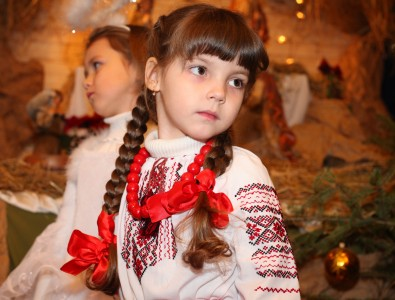 an amazingly beautiful brunette Catholic child girl performing in the Nativity scene, photo 3