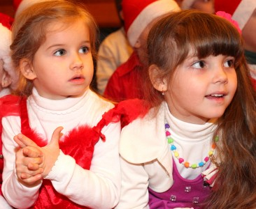 two beautiful cute Catholic girls at st. Nicholas day celebration in a Catholic kindergarten, photo 13