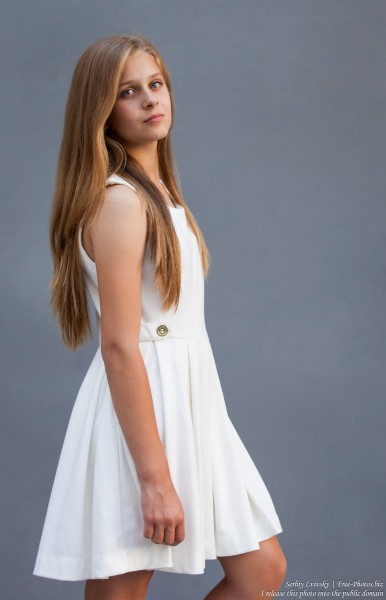 a 12-year-old blond girl wearing a white dress photographed in July 2015 by Serhiy Lvivsky, picture 11