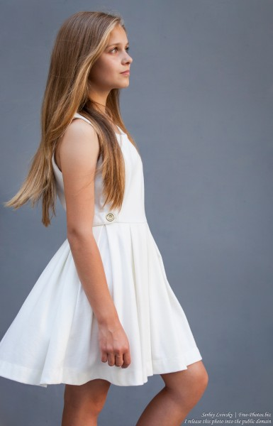a 12-year-old blond girl wearing a white dress photographed in July 2015 by Serhiy Lvivsky, picture 12