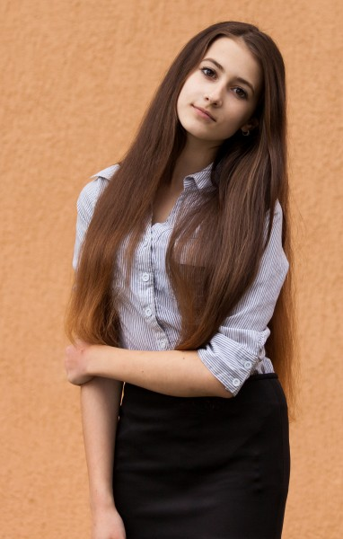 a 13-year-old brunette girl photographed in May 2015, picture 1