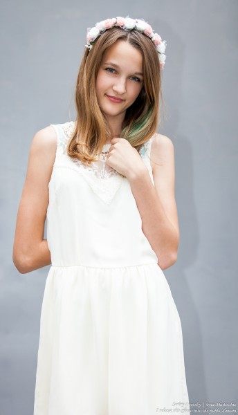 a 13-year-old Catholic girl in a white dress photographed in June 2015, picture 1