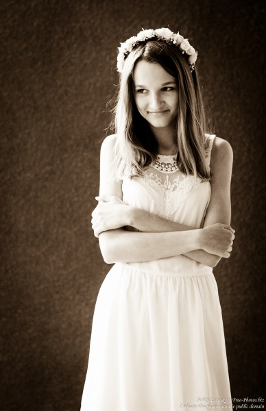 a 13-year-old Catholic girl in a white dress photographed in June 2015, picture 10