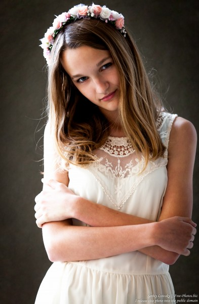 a 13-year-old Catholic girl in a white dress photographed in June 2015, picture 11