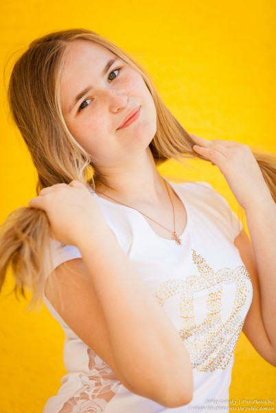 a 14-year old fair-haired girl photographed in June 2015, picture 3