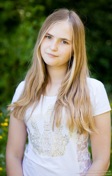 a 14-year old fair-haired girl photographed in June 2015, picture 4