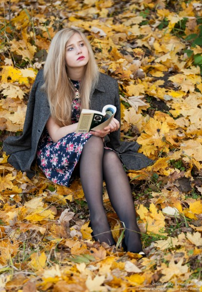 a seventeen-year-old natural blond girl with blue eyes holding a book, photographed by Serhiy Lvivsky in October 2015, picture 6