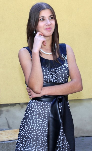an amazingly beautiful sweet appealing smiling brunette Catholic girl near a Church, photo 14