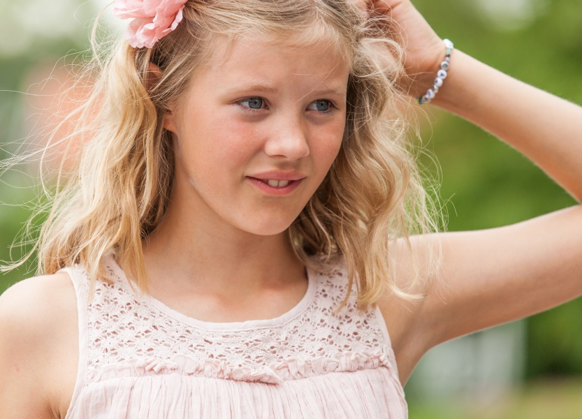 a blond beautiful girl photographed in Sigtuna, Sweden in June 2014, picture 8 out 20