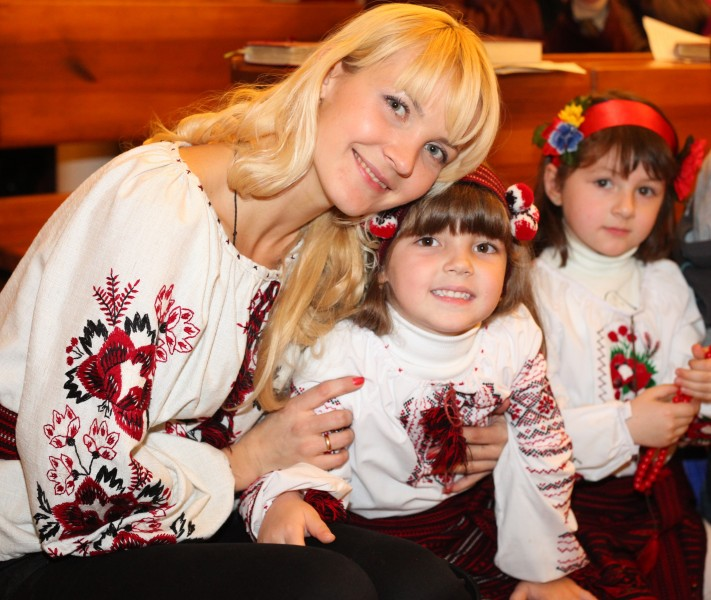 an amazingly tender and charming beautiful young blond Catholic woman with her daughter in a Church, photo 21