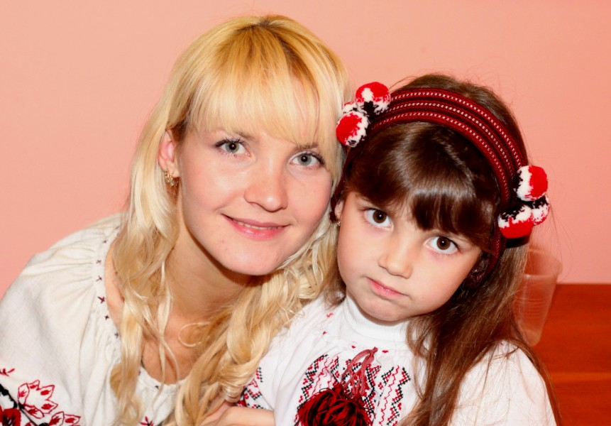 an amazingly tender and charming beautiful young blond Catholic woman with her daughter in a Church, photo 25