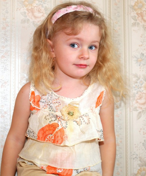a sweet beautiful child girl photographed near a room wall, picture 19