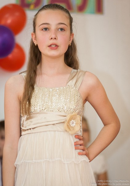 a beautiful schoolgirl wearing a dress photographed in June 2015, picture 8