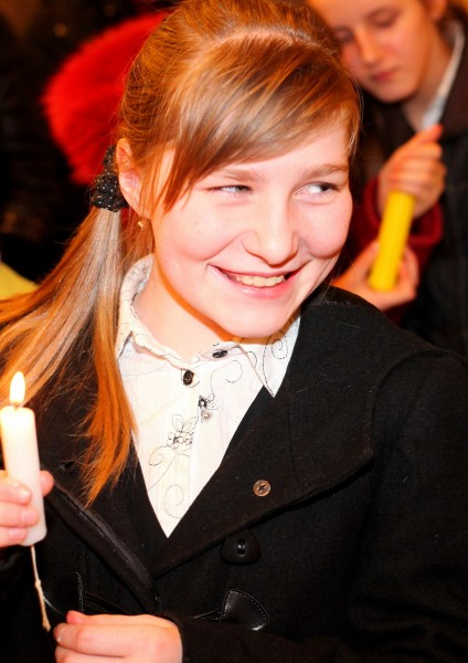 a beautiful smiling Catholic girl in a Church