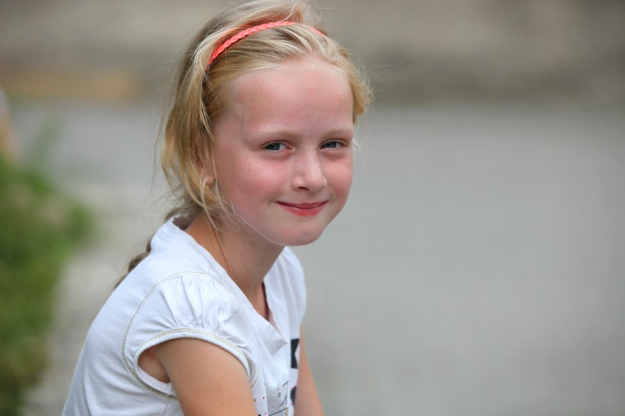 a beautiful young blond charming girl (a Catholic Christian) in a Christian camp in July 2013, picture 2/8