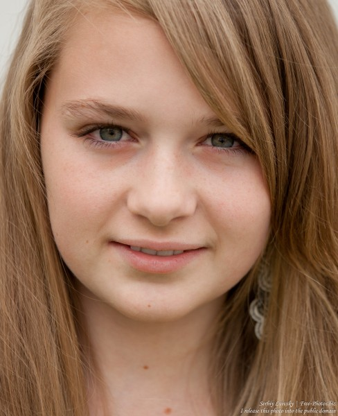 a blond 13-year-old girl photographed in June 2015, picture 1