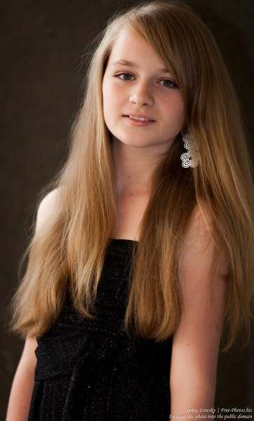 a blond 13-year-old girl photographed in June 2015, picture 3