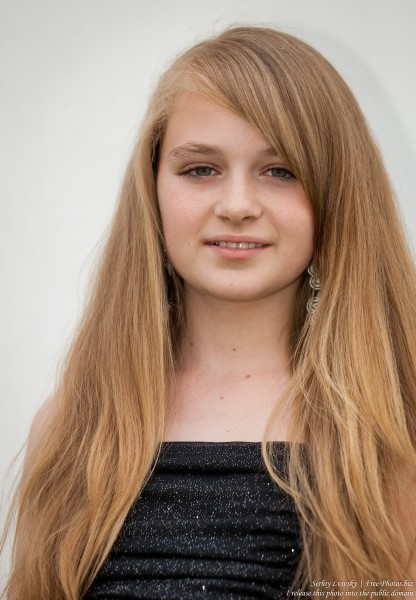 a blond 13-year-old girl photographed in June 2015, picture 8