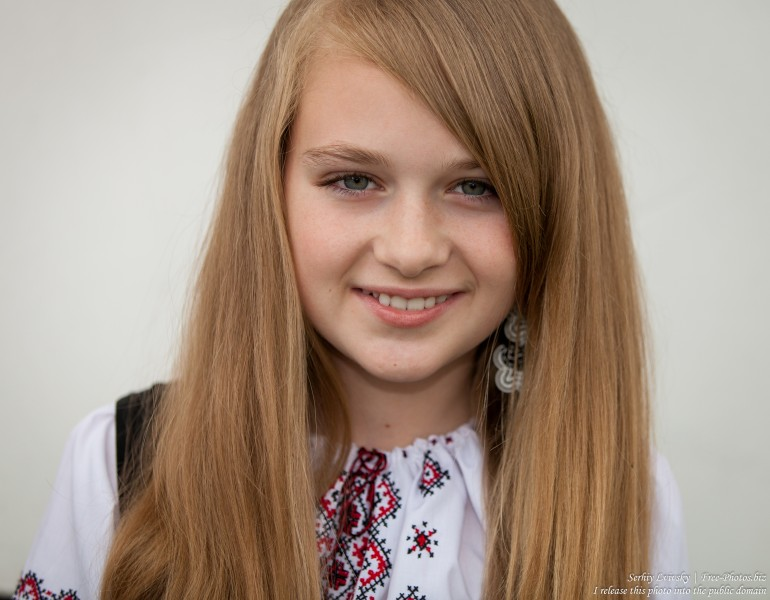 a blond 13-year-old girl photographed in June 2015, picture 20