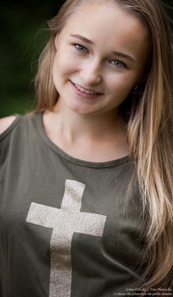 a blond 14-year-old girl with a cross depicted on her T-shirt, photographed in August 2015 by Serhiy Lvivsky, picture 3