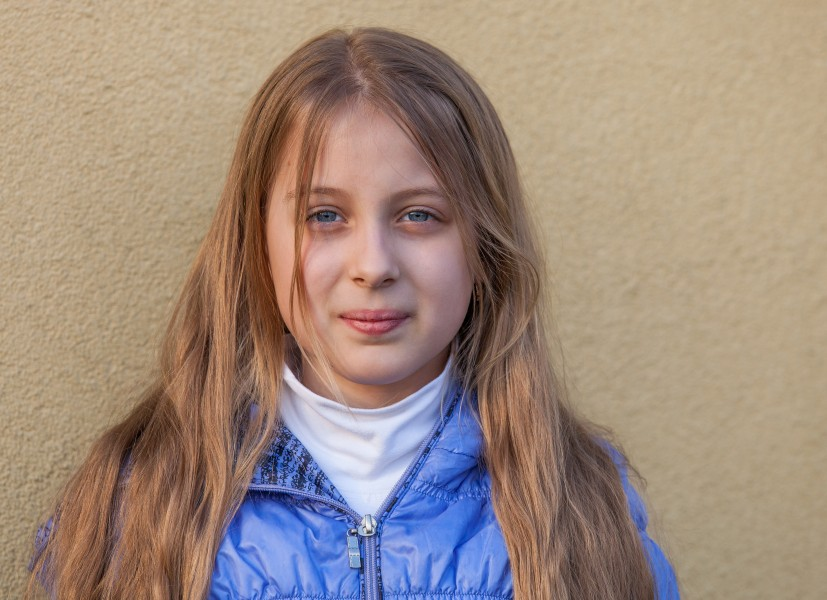 a blond long-haired Roman-Catholic girl photographed in April 2014, portrait 3 out of 11