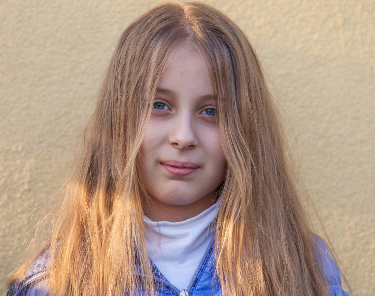 a blond long-haired Roman-Catholic girl photographed in April 2014, portrait 4 out of 11