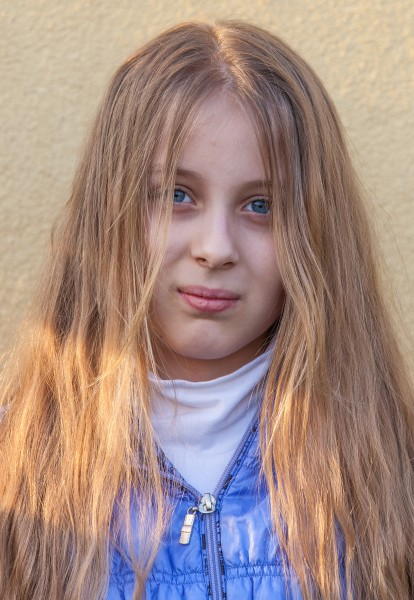 a blond long-haired Roman-Catholic girl photographed in April 2014, portrait 5 out of 11
