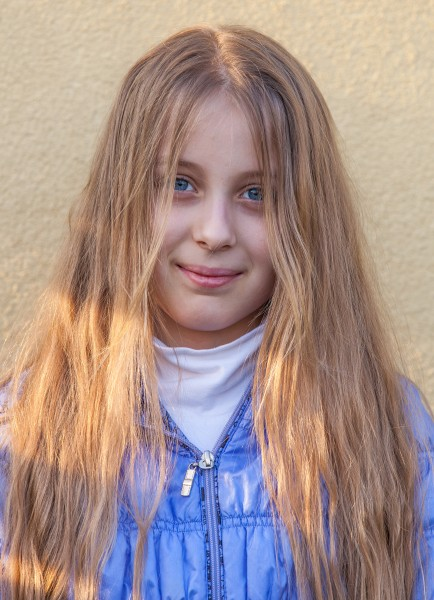 a blond long-haired Roman-Catholic girl photographed in April 2014, portrait 6 out of 11