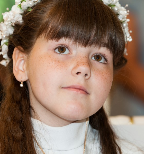 a Catholic child girl on her first Holy Communion Mass in June 2014, picture 3/4