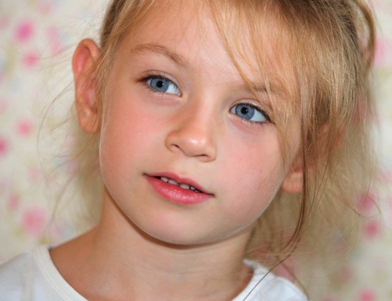 a cute Catholic child girl photographed in July 2013, portrait 1/10