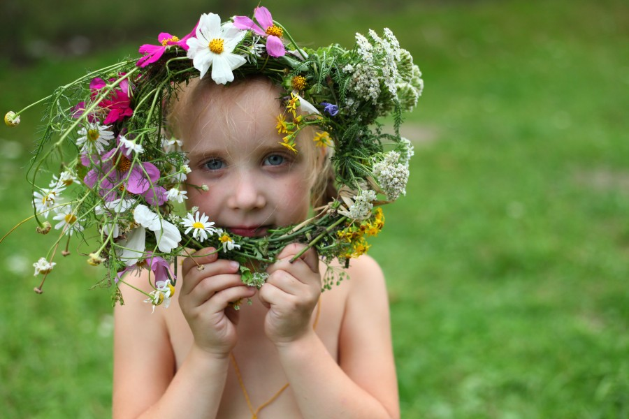 a child girl with a wreath of flowers
