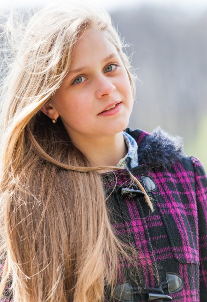a cute blond 12-year-old girl photographed in April 2015, picture 1