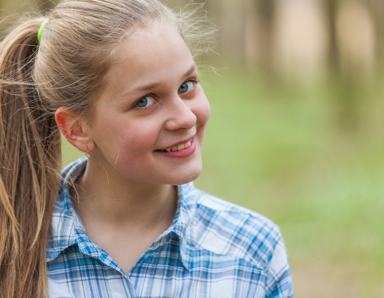 a cute blond 12-year-old girl photographed in April 2015, picture 8