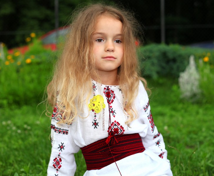 a cute blond Catholic child girl in a Catholic kindergarten in June 2013, picture 1/2