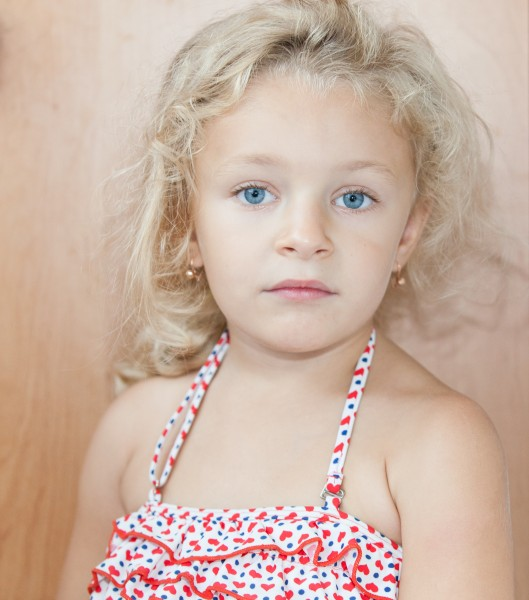 a cute blond blue-eyed child girl photographed in August 2014, picture 2