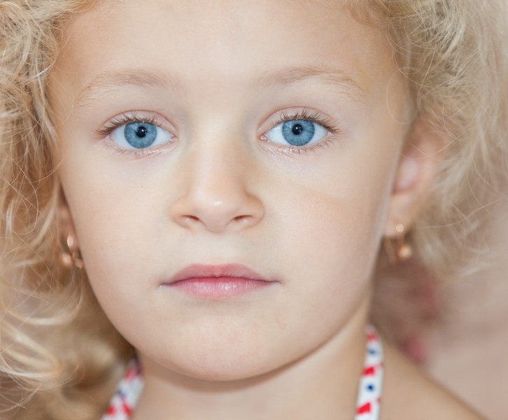 a cute blond child girl photographed in August 2014, picture 3