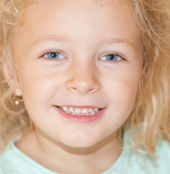a cute blond child girl photographed in August 2014, picture 5