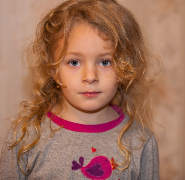 a cute blond child girl photographed in January 2014, photo 1 out of 4