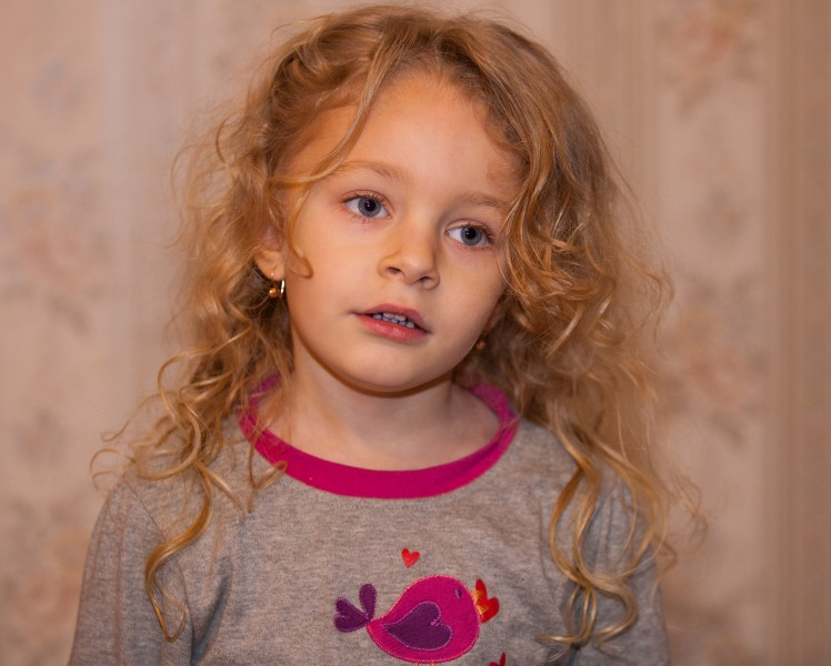 a cute blond child girl photographed in January 2014, photo 2 out of 4