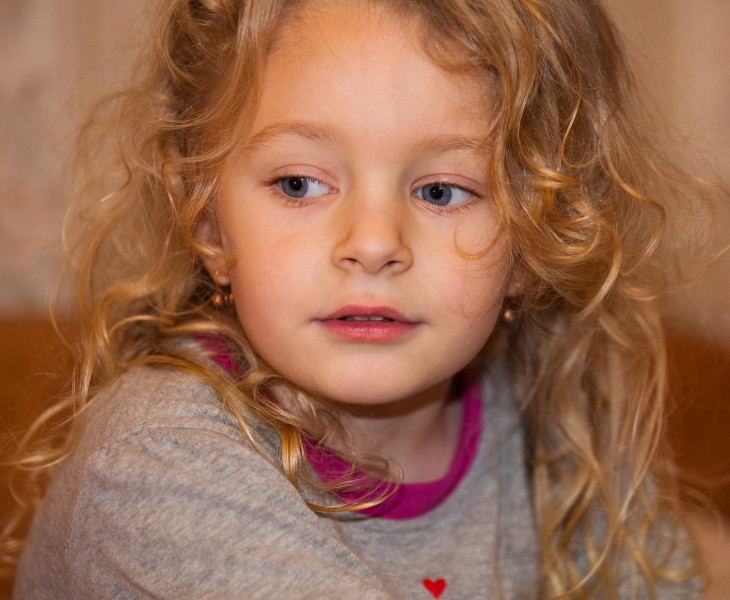 a cute blond child girl photographed in January 2014, photo 4 out of 4