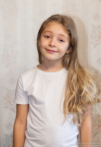 a cute blond child girl photographed in January 2017, picture 1
