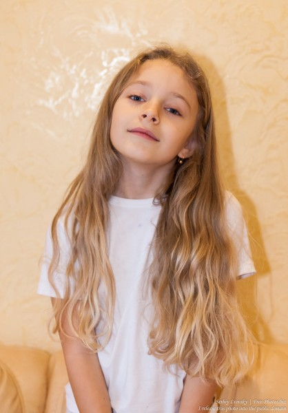 a cute blond child girl photographed in January 2017, picture 2