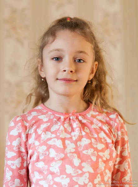 a cute blonde child girl photographed in March 2017, picture 3