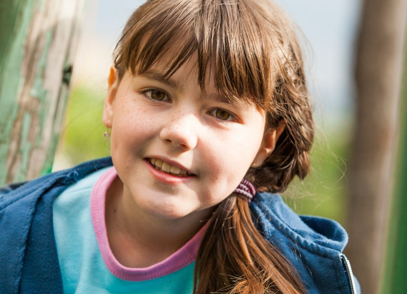 a cute brunette Catholic child girl photographed in May 2014, picture 1/5