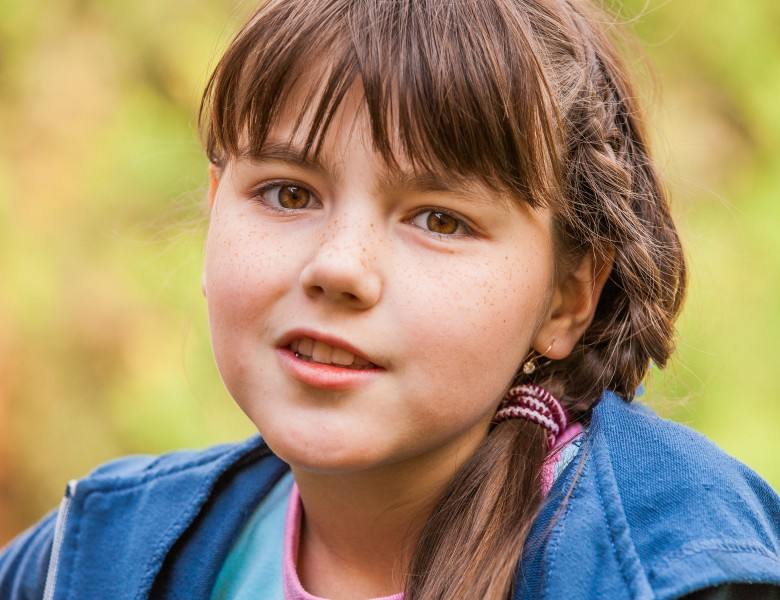 a cute brunette Catholic child girl photographed in May 2014, picture 4/5
