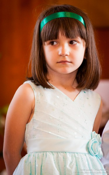 a cute brunette child girl photographed in June 2015