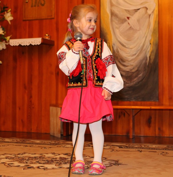 a cute charming beautiful Catholic child girl in a Church, photo 6