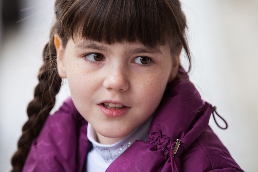 a cute child girl photographed near a Catholic chapel in November 2013, picture 1/2